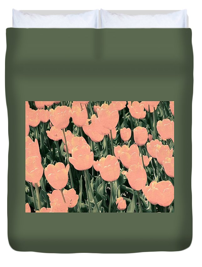 Hollander Duvet Cover featuring the photograph A Bed of Pink and Green by Michelle Calkins