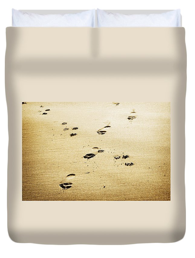 Footprint Duvet Cover featuring the photograph A Man And His Dog by Marilyn Hunt