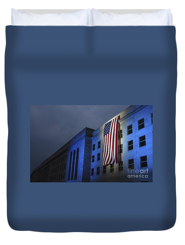 Anniversary Duvet Cover featuring the photograph A Memorial Flag Is Illuminated On The by Stocktrek Images