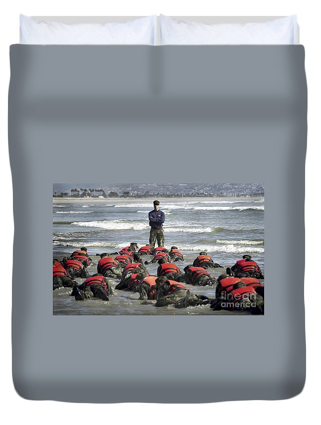 Buds Duvet Cover featuring the photograph A Navy Seal Instructor Assists Students by Stocktrek Images