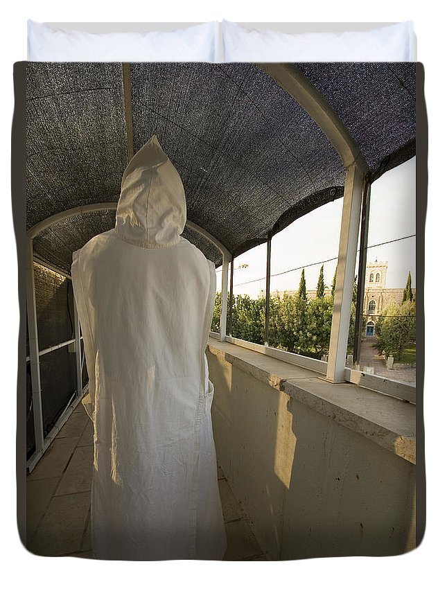 Nun Duvet Cover featuring the photograph A Nun In A Monastery by Danny Yanai