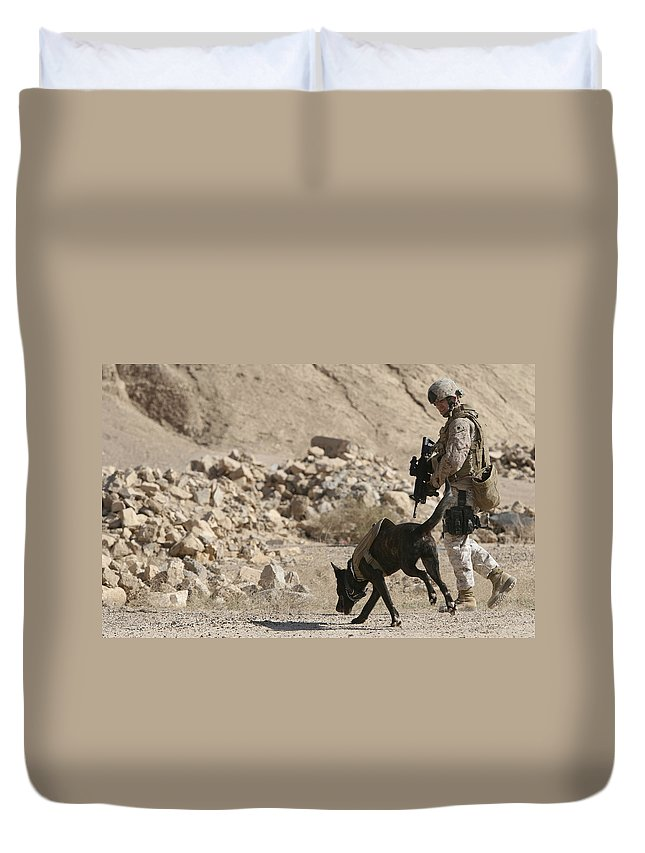 Dogs Duvet Cover featuring the photograph A Soldier And His Dog Search An Area by Stocktrek Images