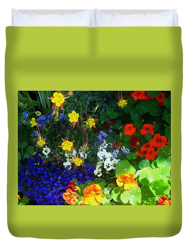 Flowers Duvet Cover featuring the photograph A Spring Garden Medley by Andrea Freeman