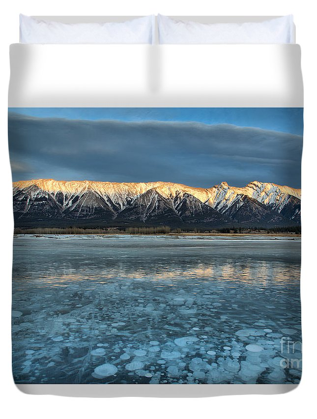 Abraham Lake Duvet Cover featuring the photograph Abraham Lake Ice Bubble Sunset by Adam Jewell