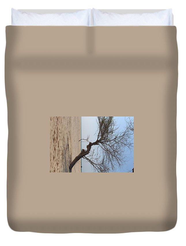 Duvet Cover featuring the photograph Alone by Adam Faidzul