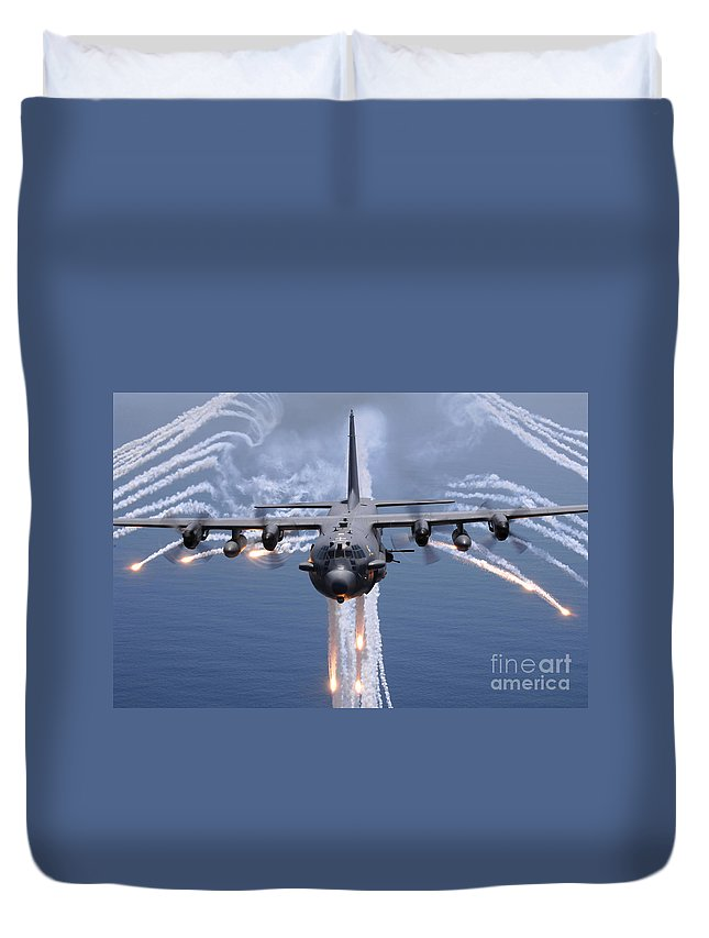 Ac-130 Duvet Cover featuring the photograph An Ac-130h Gunship Aircraft Jettisons by Stocktrek Images