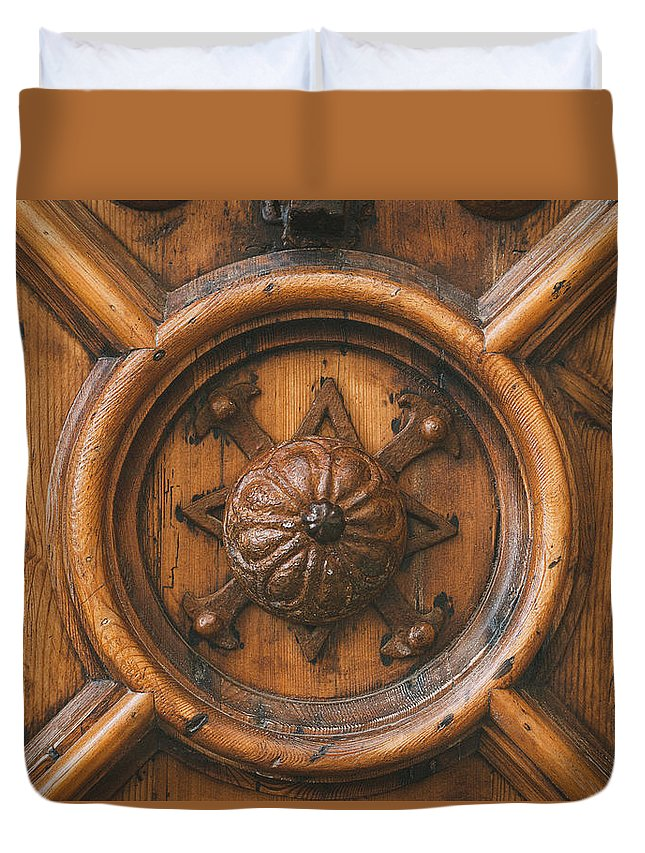 Closeup Duvet Cover featuring the photograph An Old Carved Wooden Door by Jose Luis Agudo