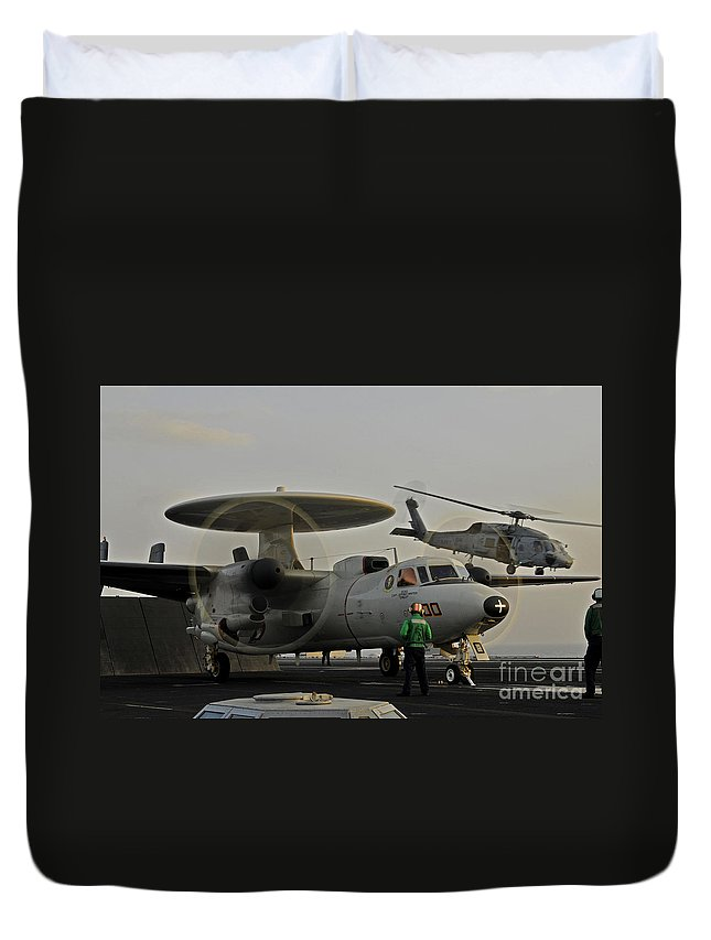 An Sh-60f Sea Hawk Helicopter Lifts Off As An E-2c Hawkeye Prepares To Launch Duvet Cover featuring the painting An Sh-60f Sea Hawk Helicopter Lifts Off by Celestial Images