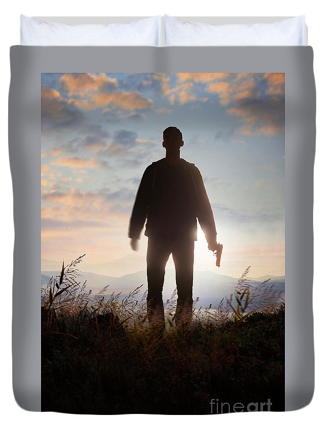 Man Duvet Cover featuring the photograph Anonymous Man In Silhouette Holding A Gun by Lee Avison