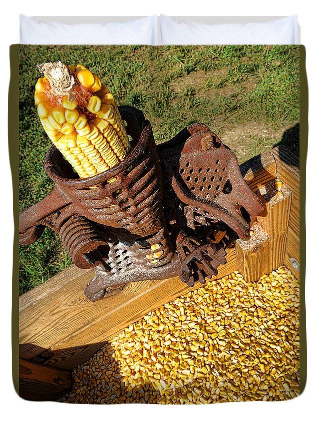 Antique Duvet Cover featuring the photograph Antique Corn Sheller by Olivier Le Queinec
