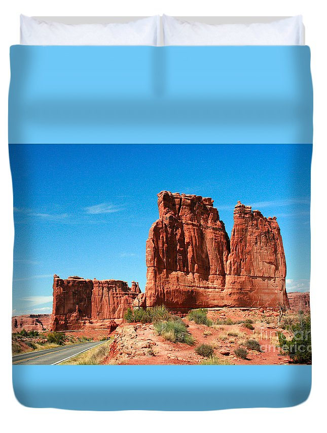 Arches National Park Duvet Cover featuring the painting Arches National Park From A Utah Highway by Corey Ford