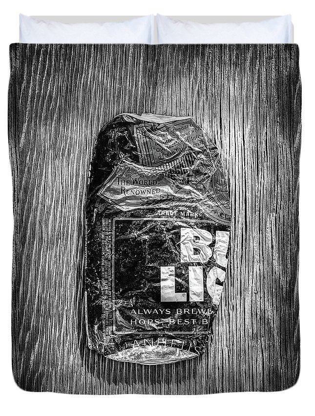 Black Duvet Cover featuring the photograph Crushed Blue Beer Can On Plywood 78 In Bw by YoPedro