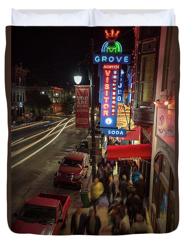 Grove Pharmacy Neon Sign Duvet Cover featuring the photograph Austin Fan Fest A Success As F1 Race Enthusiasts Pack 6th Street by Herronstock Prints