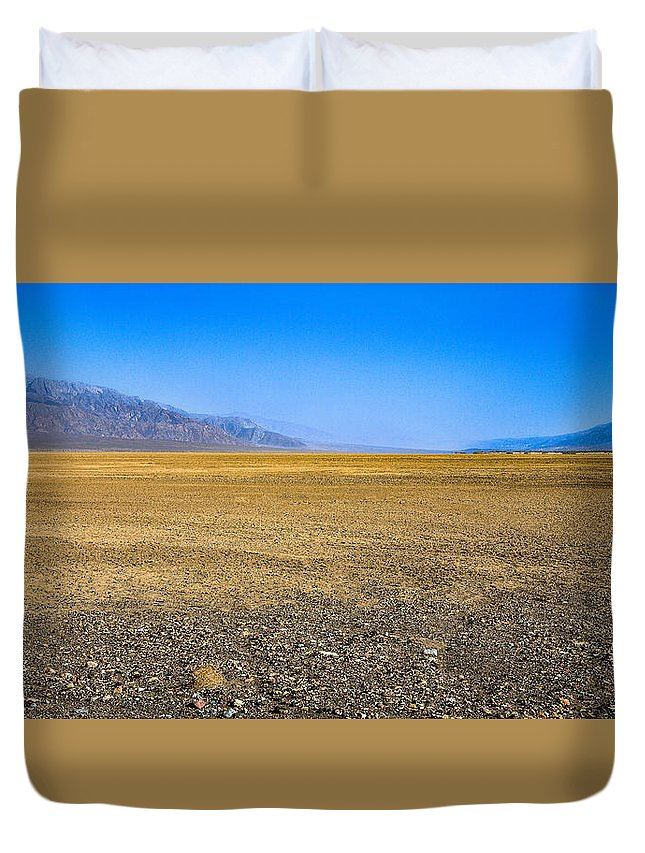 Badwater Basin Duvet Cover featuring the photograph Badwater Basin In Death Valley by John Bosma