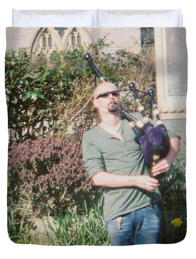Ginger Repke Duvet Cover featuring the photograph Bagpiper In Glastonbury by Ginger Repke