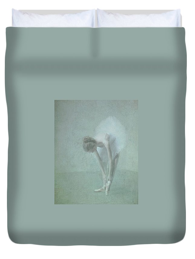 Ballerina Duvet Cover featuring the photograph Ballerina Adjusting Her Slippers by Phil Barker