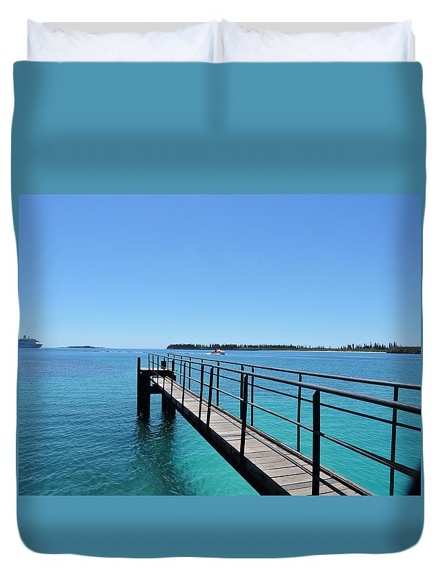Pier Duvet Cover featuring the photograph Beyond The Pier by Trevor Whitehead