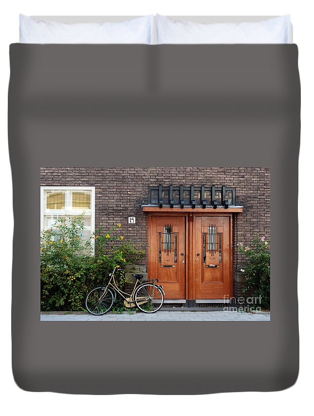 Bicycle Duvet Cover featuring the photograph Bicycle And Wooden Door by Thomas Marchessault