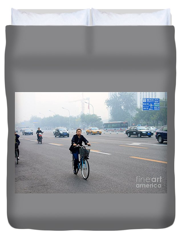 Bicycle Duvet Cover featuring the photograph Bicyclist In Beijing by Thomas Marchessault