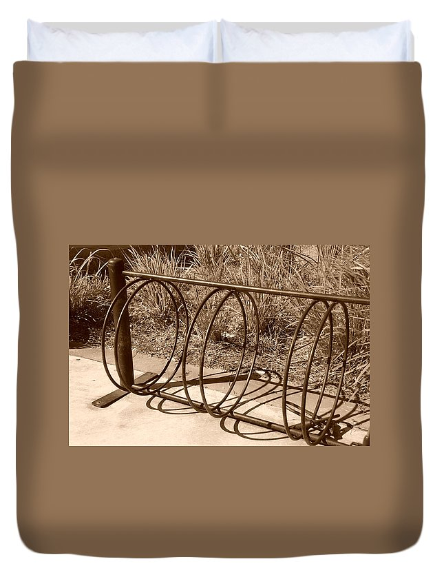 Bicycle Duvet Cover featuring the photograph Bike Rack by Rob Hans