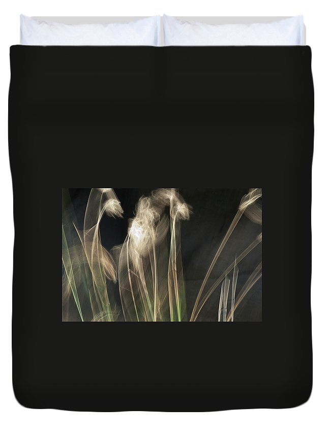 Blowing In The Wind Duvet Cover featuring the photograph Blowing In The Wind by Roger Mullenhour