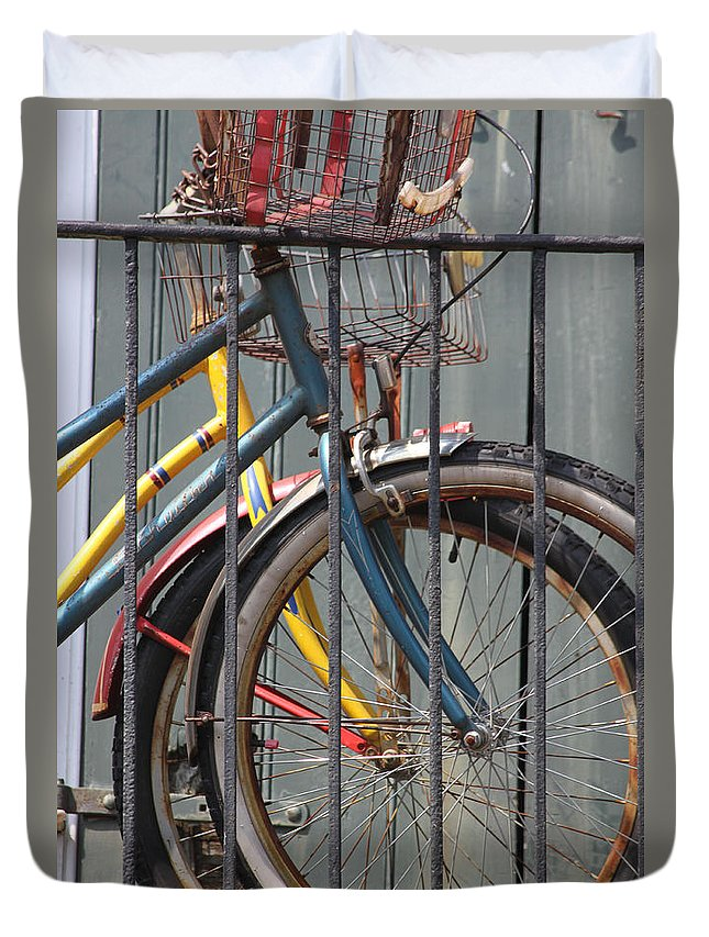 Bike Duvet Cover featuring the photograph Blue And Yellow Bikes by Lauri Novak