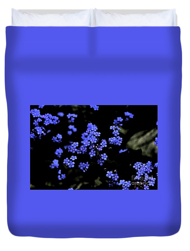 Blue Flowers Floating Duvet Cover featuring the photograph Blue Flowers Floating by David Frederick