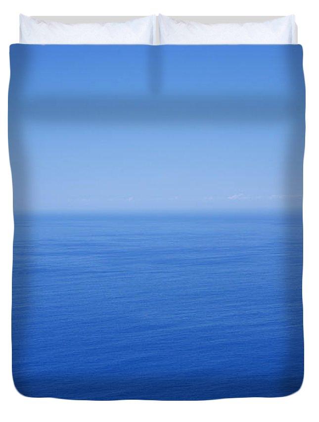 Tranquility Duvet Cover featuring the photograph Blue Horizon by Gaspar Avila