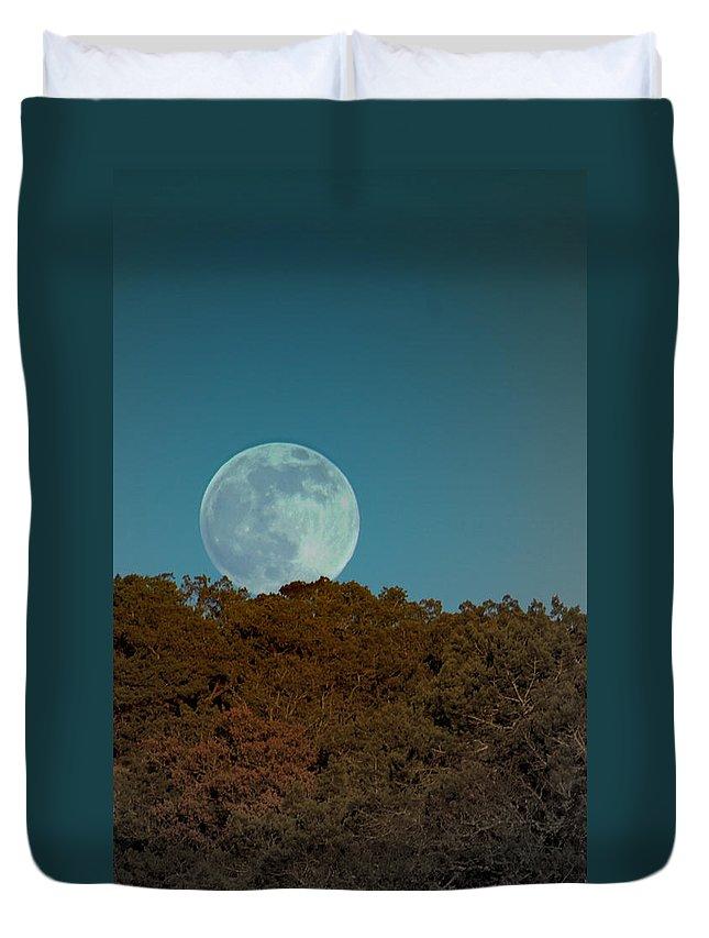 Moon Duvet Cover featuring the photograph Blue Moon Risign by Karen Musick