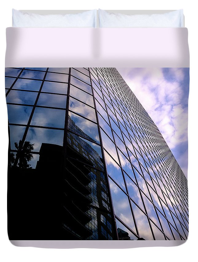 Mclenaghan Duvet Cover featuring the photograph Blue Skyscrapper With A Blue Sky In New Orleans Louisiana by Travel Back And Forth