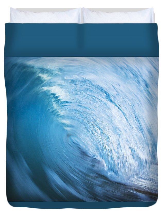 Abstract Duvet Cover featuring the photograph Blue Wave Tube Blur by MakenaStockMedia