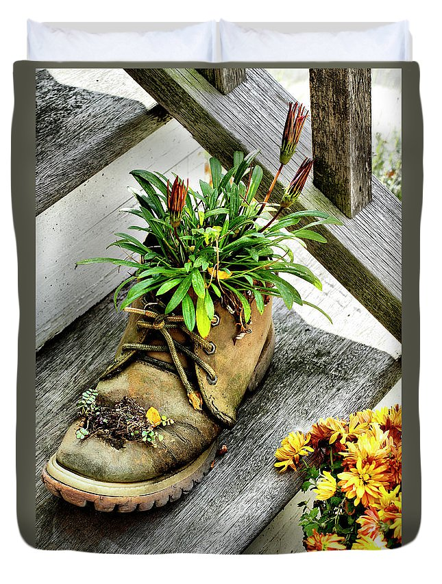 Boot Duvet Cover featuring the photograph Booted Plant by Cate Franklyn