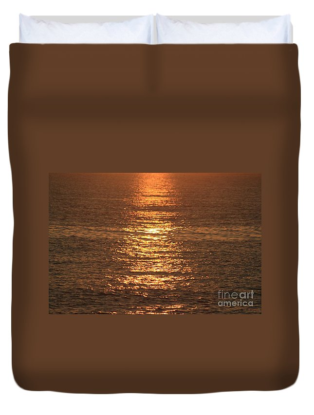 Ocean Duvet Cover featuring the photograph Bronze Reflections by Nadine Rippelmeyer