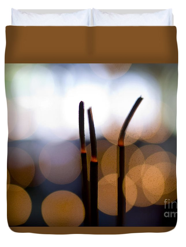 Adorn Duvet Cover featuring the photograph Burning Incense by Ray Laskowitz - Printscapes