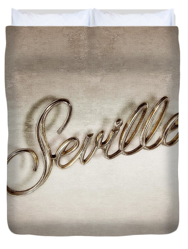 Automotive Duvet Cover featuring the photograph Cadillac Seville Emblem by YoPedro