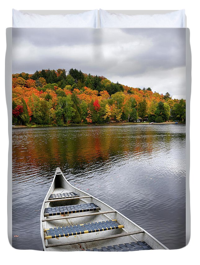 Canoe Duvet Cover featuring the photograph Canoe On A Lake by Oleksiy Maksymenko