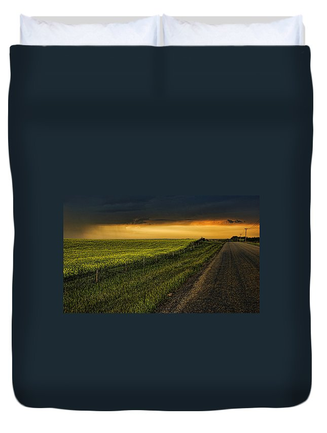 Canola Duvet Cover featuring the photograph Canola And The Road Ahead by Wayne Sherriff
