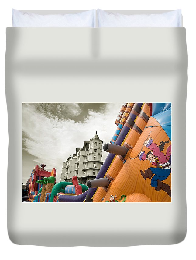Childrens Duvet Cover featuring the photograph Childrens Play Areas Contrast With The Victorian Elegance Of The Grand Hotel In Llandudno Wales Uk by Mal Bray