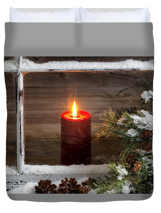 Christmas Duvet Cover featuring the photograph Christmas Red Candle With Snow Covered Home Window And Pine Tree by Thomas Baker