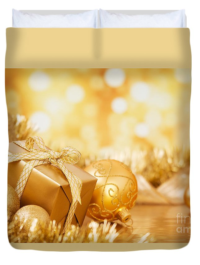 Baubles Duvet Cover featuring the photograph Christmas Scene With Gold Baubles And Gift On A Gold Background by Sara Winter