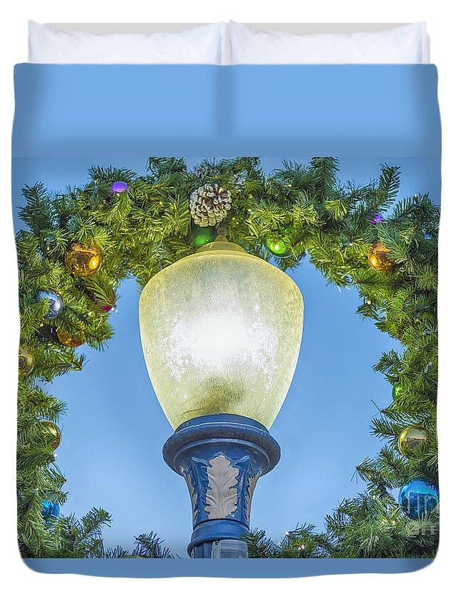 Long Beach Duvet Cover featuring the photograph Christmas Wreath Lampost by David Zanzinger