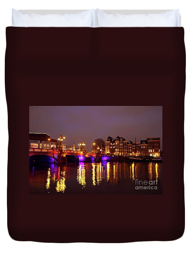 Amstel Duvet Cover featuring the photograph City Scenic From Amsterdam With The Blue Bridge In The Netherlands by Nisangha Ji