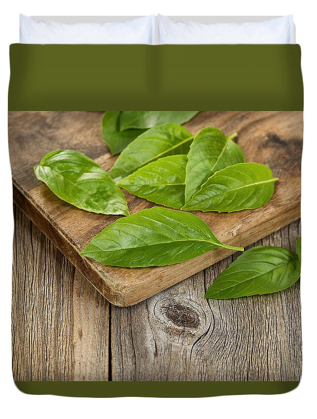 Basil Duvet Cover featuring the photograph Close Up Fresh Basil Leafs On Rustic Serving Board by Thomas Baker