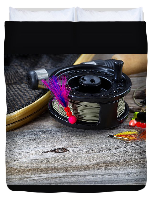 Fishing Duvet Cover featuring the photograph Close Up Of Fly Reel With Fly Jig Hanging From Spool by Thomas Baker