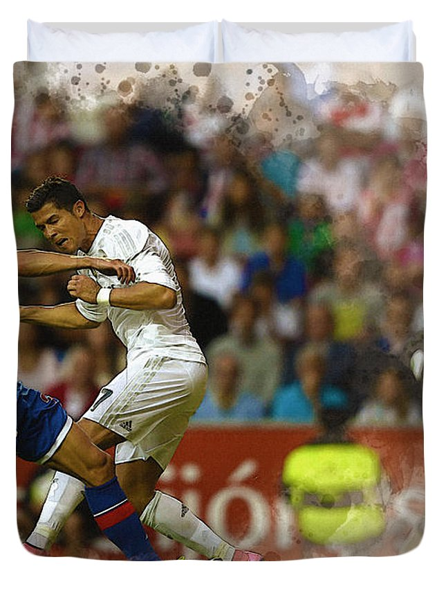 Uefa Chamipons League Duvet Cover featuring the digital art Cristiano Ronaldo Heads The Ball During The Spanish League Footb by Don Kuing