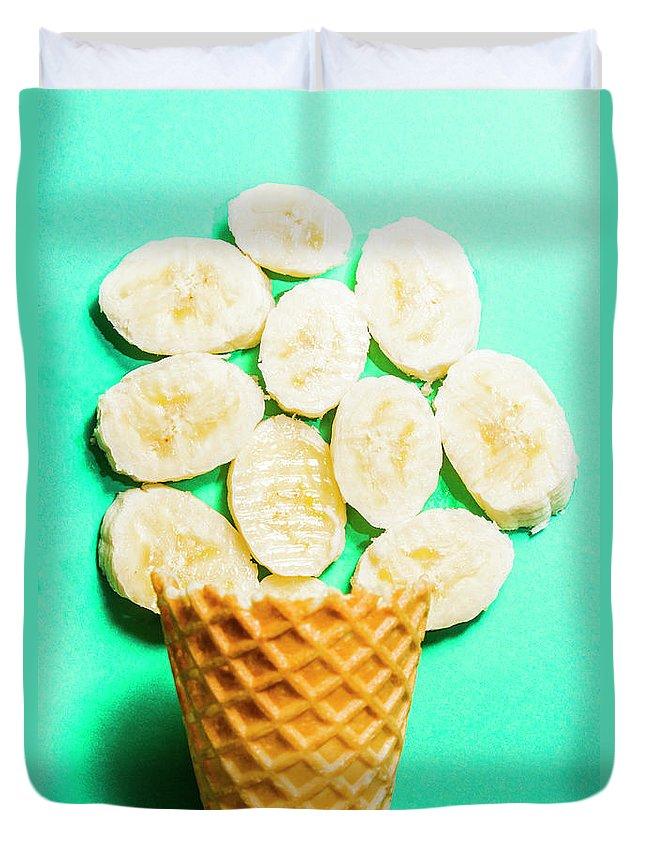 Banana Duvet Cover featuring the photograph Dessert Concept Of Ice-cream Cone And Banana Slices by Jorgo Photography - Wall Art Gallery