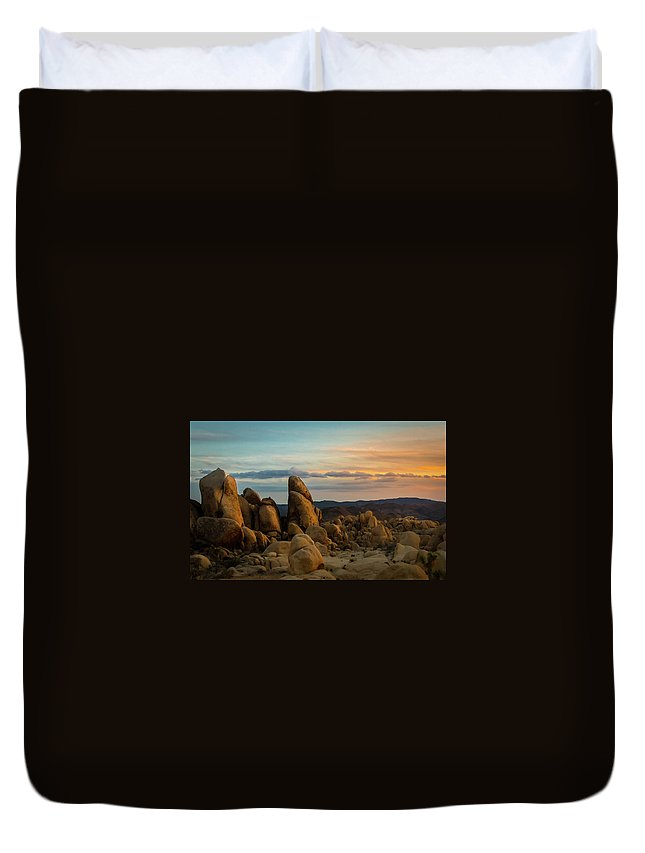 Sky Duvet Cover featuring the photograph Desert Rocks by Ed Clark
