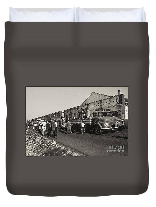 Lisbon Portuguese Republic Portugal Men Man Woman Women People Person Persons Creature Creatures Dock Workers Docks Worker Truth Trucks Warehouse Warehouses Cityscape Cityscapes City Cities Black And White Sepia Duvet Cover featuring the photograph Dock Workers 3 by Bob Phillips