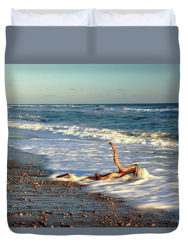 Driftwood Duvet Cover featuring the photograph Driftwood In The Surf by Roupen Baker