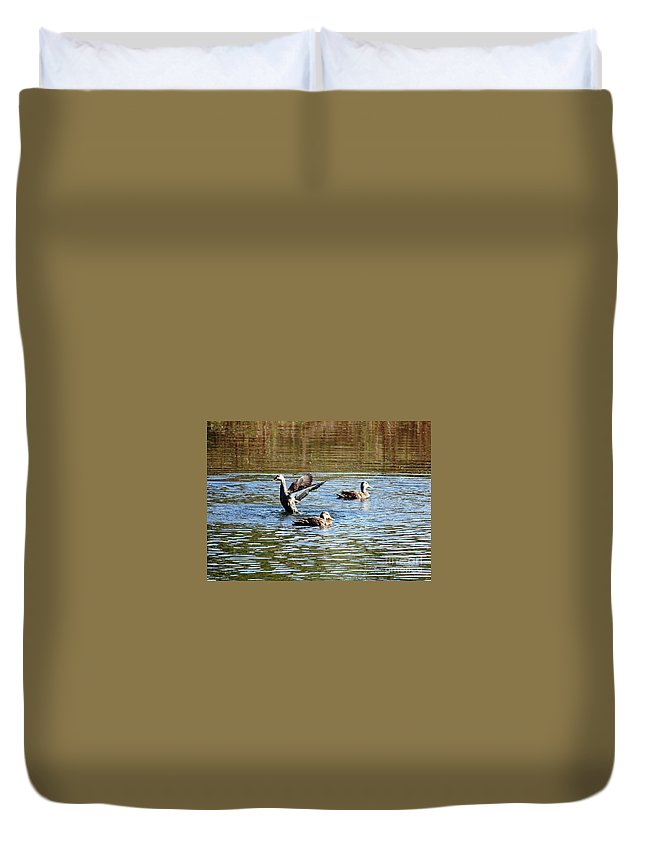 Ducks Duvet Cover featuring the photograph Ducks On Colorful Pond by Carol Groenen